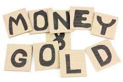 Dinero y oro Fotos de archivo libres de regalías