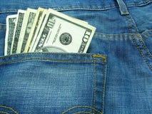 Dinero y pantalones vaqueros 4 Fotografía de archivo libre de regalías