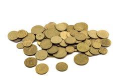 Dinero y peniques ucranianos en un fondo blanco Fotografía de archivo libre de regalías