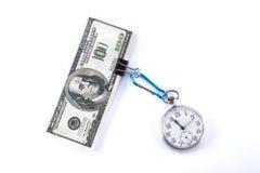 Dinero y reloj aislados imagenes de archivo