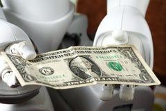 Dinero y robot Fotografía de archivo libre de regalías