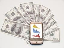 Dinero y teléfono celular Fotografía de archivo libre de regalías
