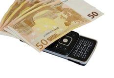 Dinero y teléfono Imagen de archivo