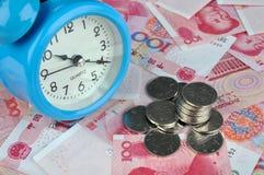 Dinero y tiempo Imagen de archivo libre de regalías