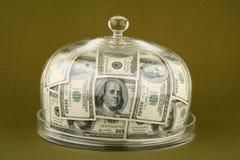 Dinero y vidrio de alarma foto de archivo