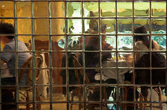 Diners. People at a restaurant seen through a glass block wall royalty free stock images