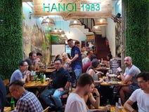 Diners at Bia Hoi Restaurant, Hanoi, Vietnam. Patrons dining at Bia Hoi Restaurant in Hanoi, Vietnam at night stock photo