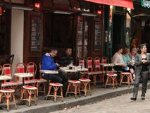 Diners enjoy a lunch at an outdoor bistro Royalty Free Stock Image