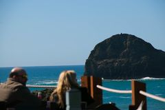 Diners enjoying lunch at an ocean view restaurant at Trebarwith Stand in Cornwall, England stock photos