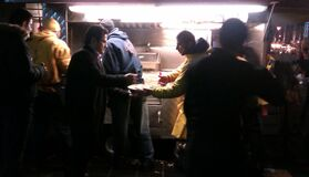 Diners outside food truck Stock Images