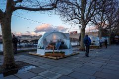 Diners in pop-up private `pods` / Igloos , London stock photos