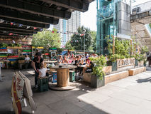 Diners relax in August sun at outdoor cafe on London's South Ban Stock Photo