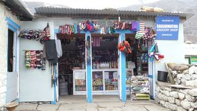 Shop Dingboche Nepal Himalayas Building Mountains Tourism Travel 4k. DINGBOCHE, NEPAL - APRIL, 2018:  typical food and equipment store near the hiking trail in stock video footage
