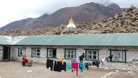 Dingboche Nepal Himalayas Building Buddhist Stupa Mountains 4k. DINGBOCHE, NEPAL - APRIL, 2018: typical guest house for tourists on the background of Buddhist stock video