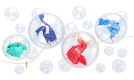 Dingen die in zeepbels vallen Stock Afbeelding
