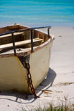 Dingey by the beach. A Wooden Boat anchored to the Beach stock photo