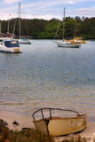 A Dingey. A Dinghy anchored at Shore stock images