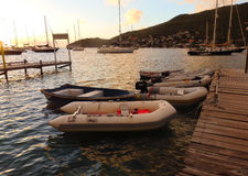 Dinghies tied to a dock for happy hour in the caribbean Royalty Free Stock Image