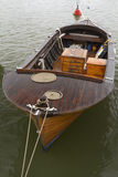 Dinghy. Wooden boat, moored near the shore royalty free stock photo