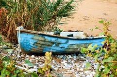 Dinghy, abandoned on beach Stock Photos