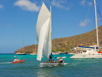 A dinghy arriving for a race in the caribbean Stock Photos