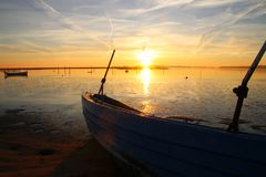Dinghy on the beach at sunset so lovely Royalty Free Stock Image