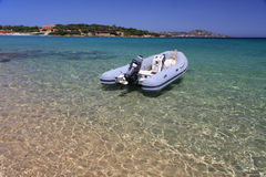 Dinghy boat. Moored on clear and turquoise water Royalty Free Stock Photo