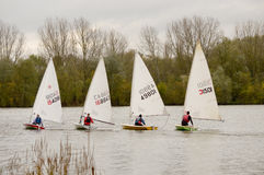 Dinghy boat racing. BEDFORD, BEDFORDSHIRE, ENGLAND - NOVEMBER 2013: , shown on 24 November 2013 at Priory Marina, Bedford Stock Photography