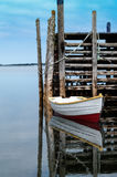 Dinghy and dock Stock Photography