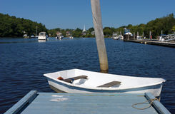 Dinghy at end of dock Stock Photos