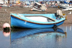Dinghy at low tide Stock Photos