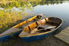 Dinghy Paddle Boat on Clear Water. Oar. Closeup View of Dinghy Paddle Boat on Clear Water. Oar royalty free stock image