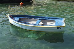 Dinghy in the Portofino harbor, Italy. stock photo