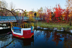 The dinghy in river and autumn forest sunset Stock Photography