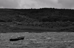 Dinghy on the scottish lake bw Royalty Free Stock Photos