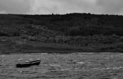 Dinghy on the scottish lake bw Royalty Free Stock Photos