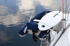 Dinghy on the stern of yacht. Stock Photo