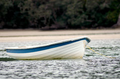 Dinghy on water Stock Images