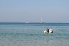 Dinghy on water sea, beach,Layan beach in Phuket, Stock Photo