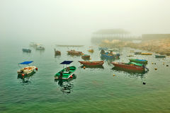 The dinghy and wharf in fog Stock Image