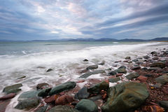 Dingle Bay. Incoming tide washes over rocks and sand at Rossbeigh Strand in Dingle Bay, Co.Kerry, Republic Of Ireland Royalty Free Stock Photography