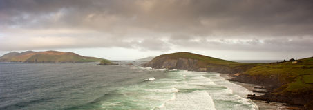 Dingle Peninsula. The Dingle Peninsula (Irish: Corca Dhuibhne – anglicised as Corkaguiny, the name of the corresponding barony) is the northernmost of the Stock Photography