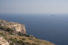Dingli Cliffs, Malta. View over the famous Dingli Cliffs to the faint island of Filfla, Malta Stock Image