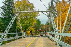 Dingmans Ferry Bridge across the Delaware River in the Poconos Mountains, connecting the states of Pennsylvania and New Jersey, US. A stock photography