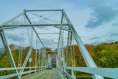 Dingmans Ferry Bridge across the Delaware River in the Poconos Mountains, connecting the states of Pennsylvania and New Jersey, US. A royalty free stock photography