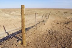 Dingoe fence in the Australian Outback. Royalty Free Stock Photography