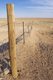 Dingoe fence in the Australian Outback. Royalty Free Stock Images