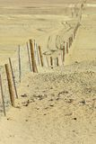 Dingoe fence in the Australian Outback. Stock Photography