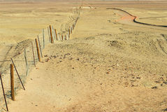 Dingoe fence in the Australian Outback. Stock Photos