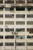 Dingy Building Side. With windows window air conditioning units scaffolding and grime from Hong Kong Royalty Free Stock Photography
